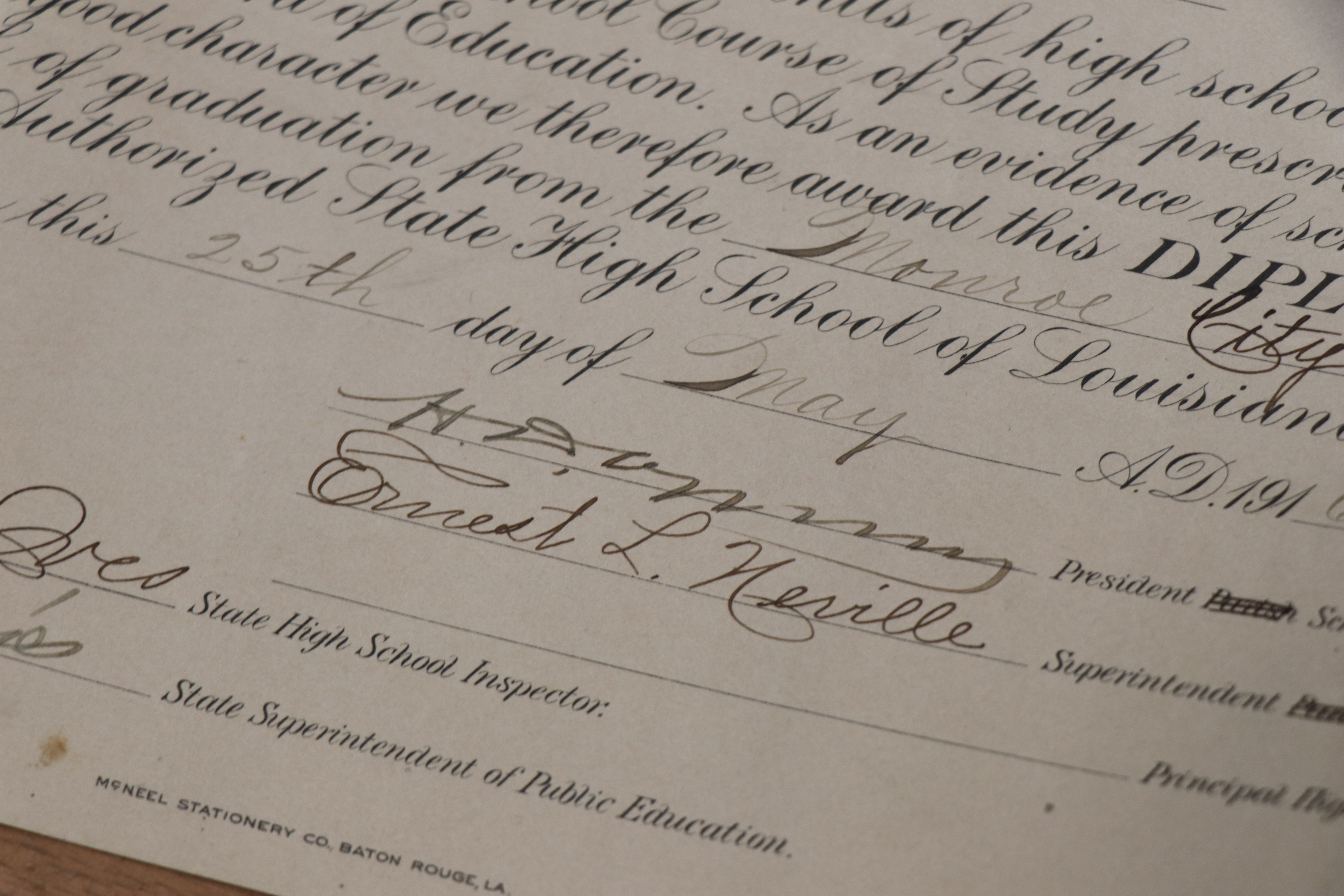 A high school diploma featuring Ernest L. Neville's signature
